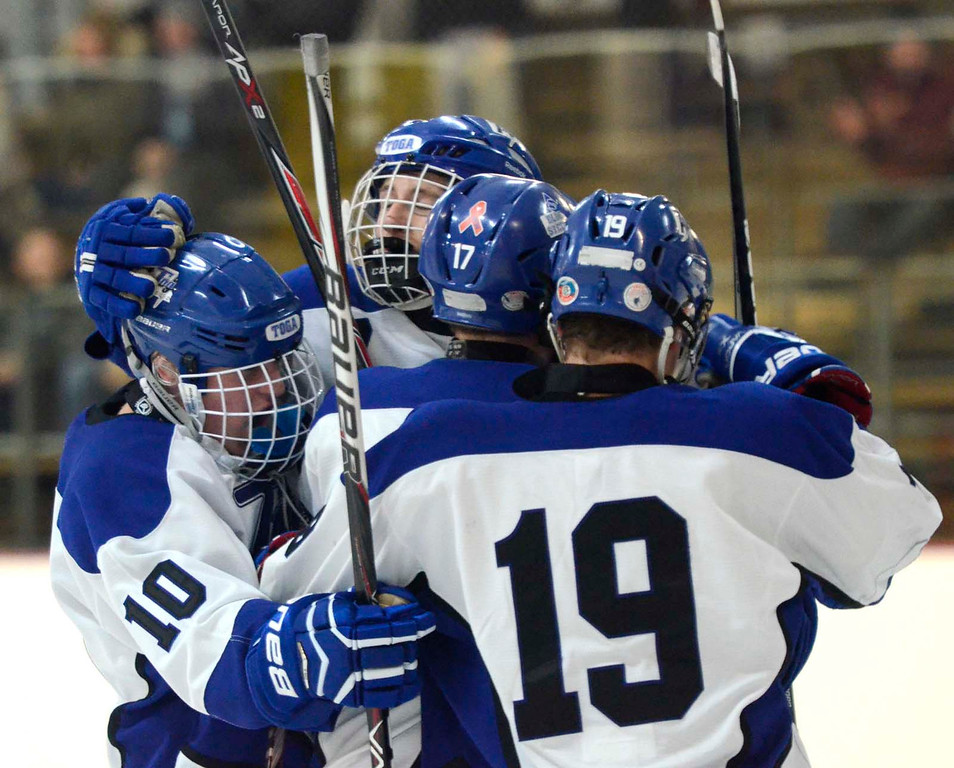 Description of . Ed Burke - The Saratogian 12/07/13 Saratoga's Devin Coffey, center facing, celebrates with fellow Blue Streaks after scoring against St. Joseph's during Saturday's action in the Don Kauth Memorial Tournament at Saratoga Springs Ice Rink.