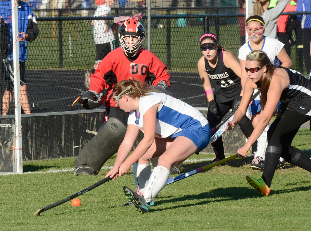 Description of . Ed Burke - the Saratogian 10/29/13 Glens Falls goalie Haylee Mello keeps her eye on the ball as South High's Kelsey Baldwin looks for a shot during Glens Falls Class B semi-final loss Tuesday in South Glens Falls.