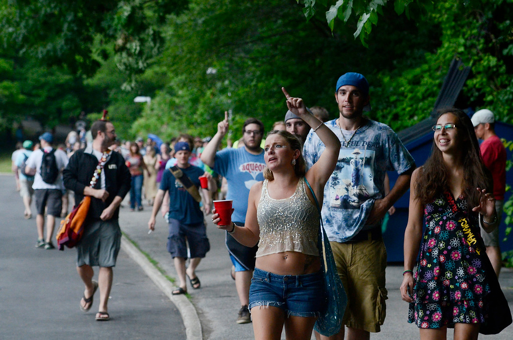 Description of . Erica Miller @togianphotog - The Saratogian:    On Thursday July 3rd 2014, Saratoga Springs was packed with thousands of Phish fans for their first of three concert nights at SPAC. Patrons made their way over the bridge towards the SPAC entrance.