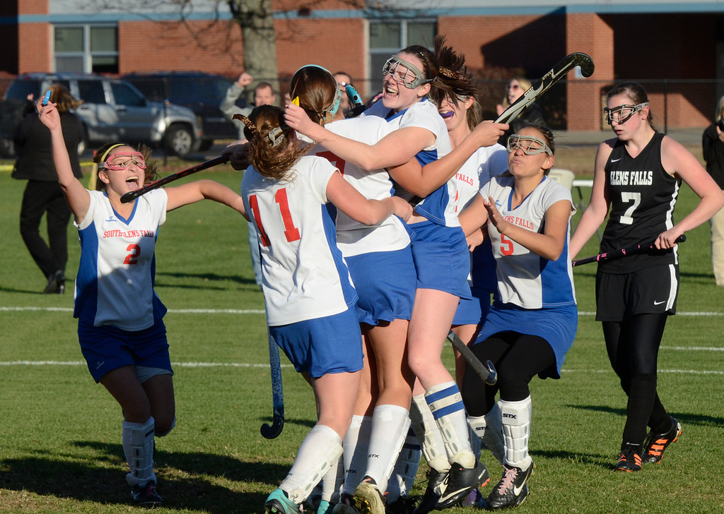 Description of . Ed Burke - the Saratogian South High varsity field hockey players celebrate after Emily Sharpe's (7) goal during the Bulldogs 1-0 semi-final win over Glens Falls Tuesday at South Glens Fall High School.