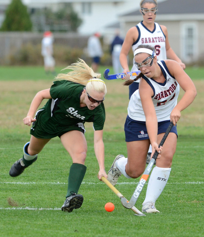 Description of . Saratoga's Anne Mahoney battles with Shen's Caroline Cady during Wednesday's varsity field hockey game at Saratoga. Ed Burke -  The Saratogian 10/16/13