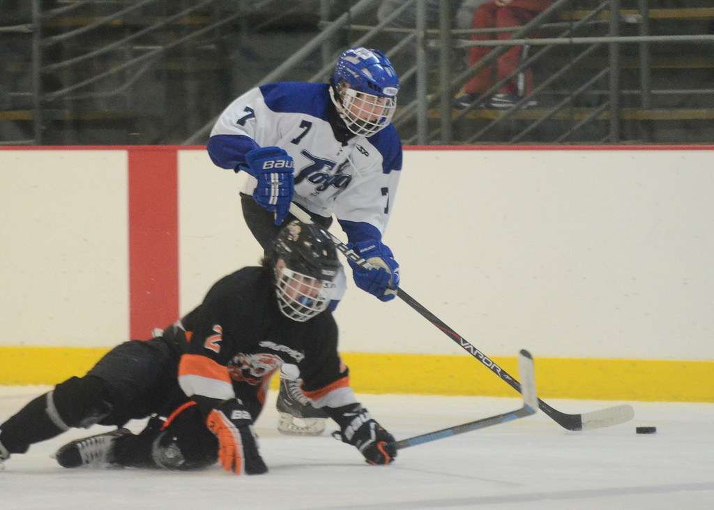 Description of . Ed Burke - The Saratogian 12/06/13 Saratoga's Devin Coffey skates around Mamaroneck's Cooper Lavan Friday in the opening round of the Don Kauth Memorial Tournament.
