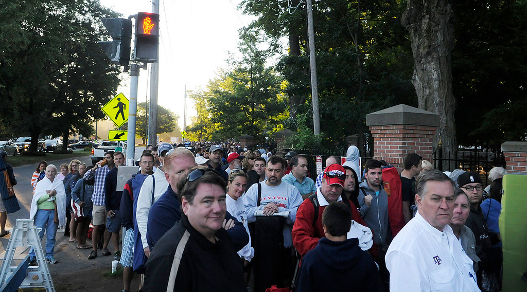 Description of . A huge line is made on Union Ave outside the Saratoga Race Course entrance gate before the crowd is allowed to enter to line up at the main entrance.Photo Erica Miller/The Saratogian 8/24/13 news_TheMadDash1