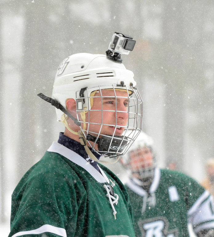 Description of . Ed Burke - The Saratogian 01/25/14 Playing for team Beercat University, Joe Livsey of Buffalo wears a video camera on his helmet Saturday during the Saratoga Frozen Springs Classic Hockey Tournament at Saratoga Spa State Park.