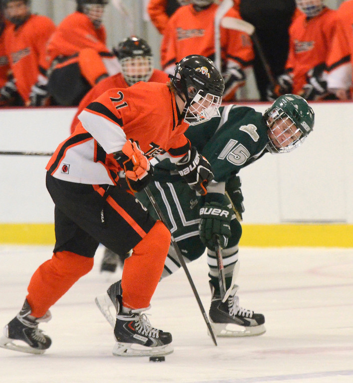 Description of . Ed Burke - The Saratogian 12/07/13 Shen's Marvin Tucker reaches for the puck past Mammaroneck's Ryan LeBlanc during Saturday's action in the Don Kauth Memorial Tournament at Saratoga Springs Ice Rink.