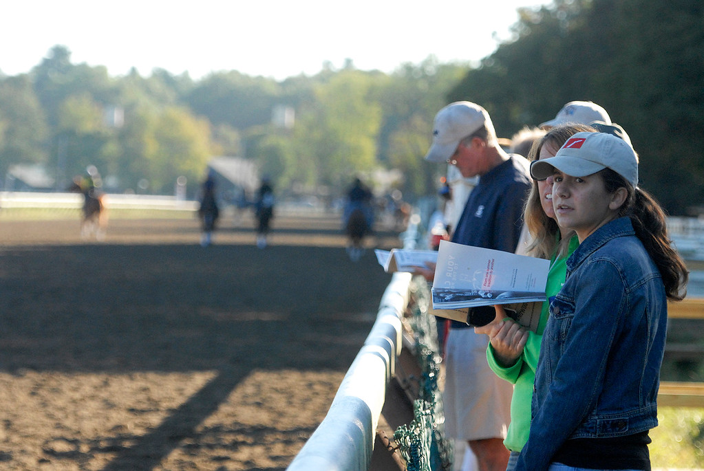 Description of . People line up on the backstretch to view early morning workouts on the Saratoga Race Course, hours before opening hours for the Travers Day on Saturday morning.Photo Erica Miller/The Saratogian 8/24/13 news_TheMadDash10