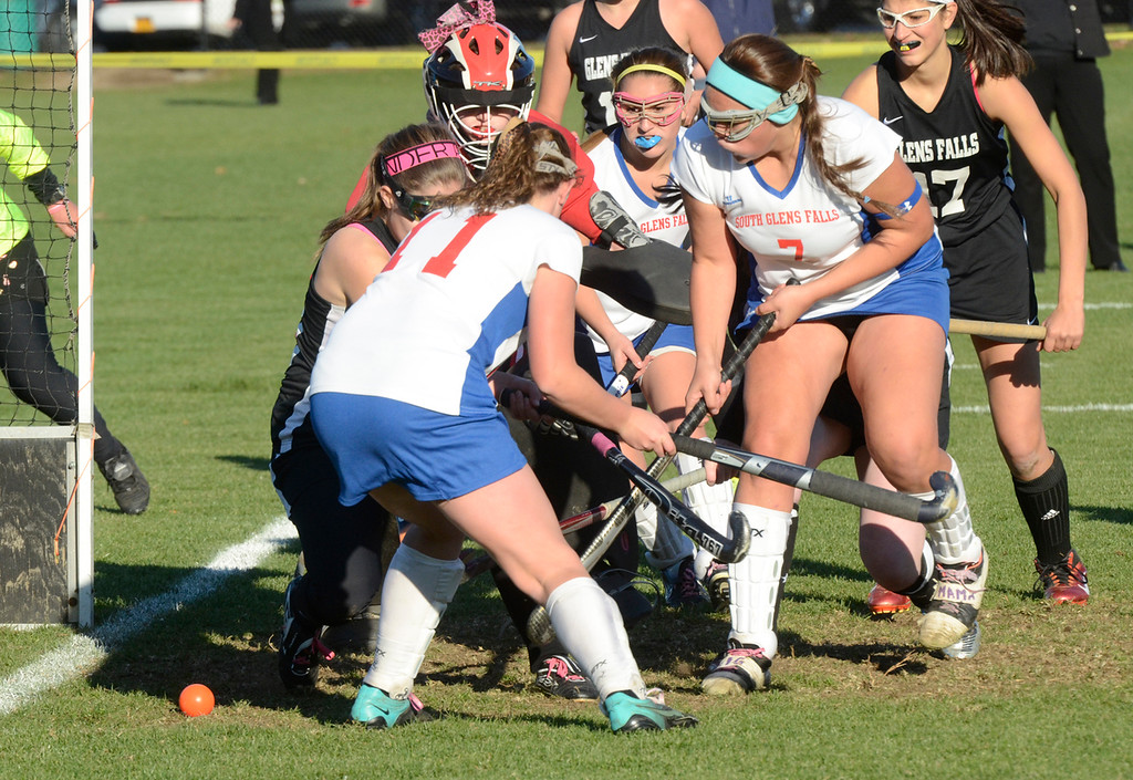 Description of . Ed Burke - the Saratogian South High's Emily Sharpe (7) scores during Tuesday's varsity field hockey semi-final win over Glens Falls at South Glens Fall High School.