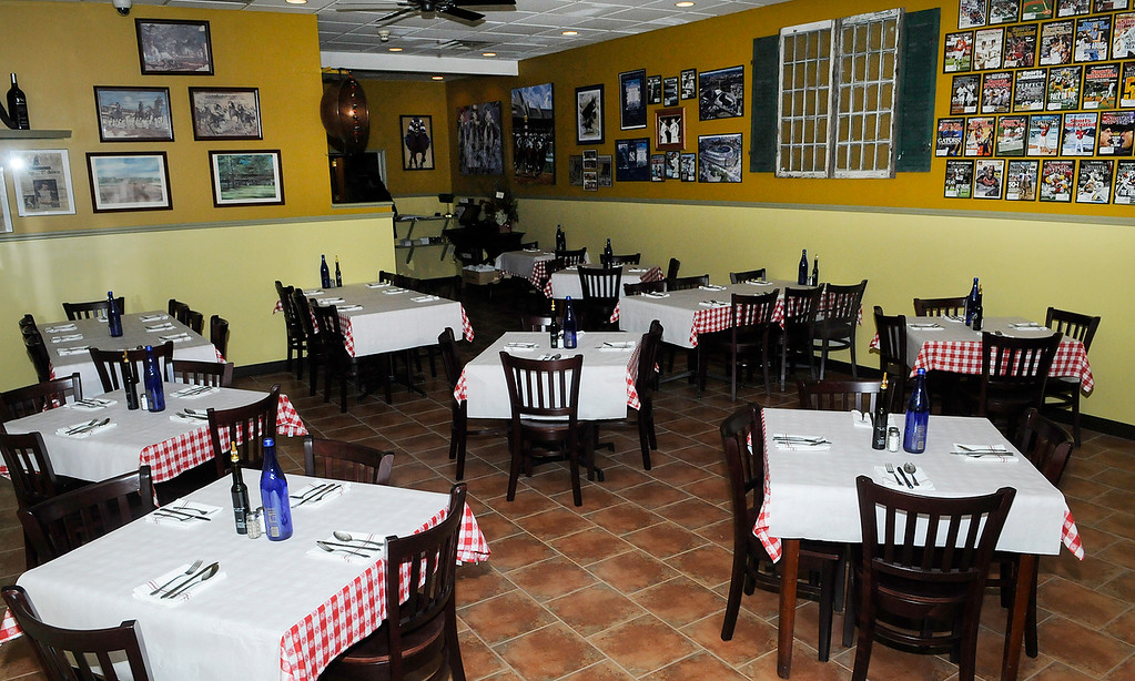 Description of . Erica Miller - The SaratogianAugie's restaurant will be opening their doors Wednesday evening in their new temporary home at the former Manna's on Low Street in Ballston Spa. Augie's restaurant was burnt in this summer.SAR-l-AugieOpens8