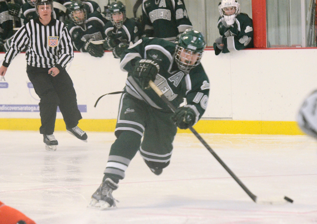 Description of . Ed Burke - The Saratogian 12/07/13 Shen's Peter Sacks scores against Mamaroneck during Saturday's action in the Don Kauth Memorial Tournament at Saratoga Springs Ice Rink.