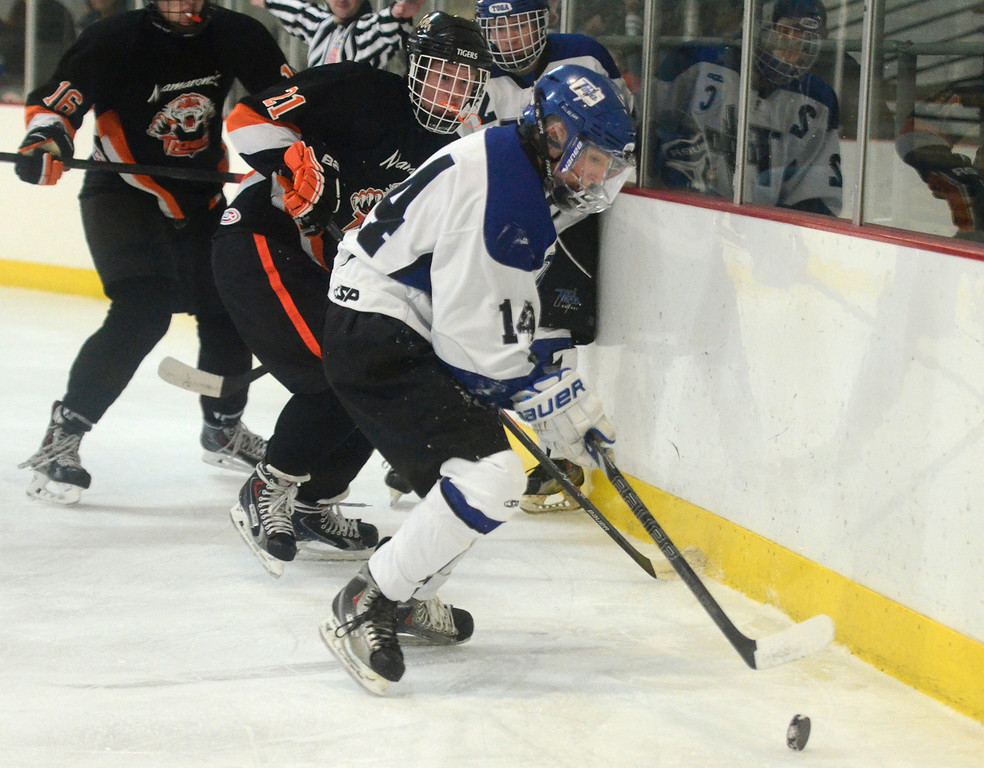 Description of . Ed Burke - The Saratogian 12/06/13 Saratoga's Drew Patterson works the puck behind the net as Mamaroneck defenders close in during Friday's opening round of the Don Kauth Memorial Tournament.