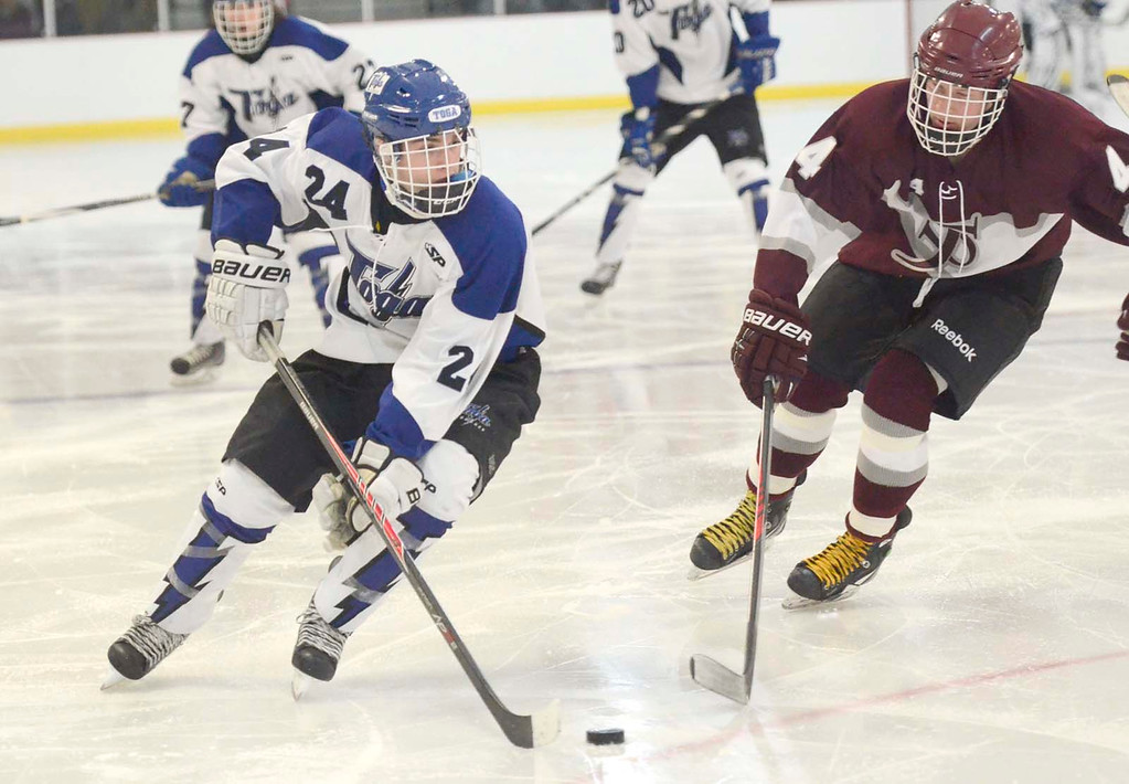Description of . Ed Burke - The Saratogian 12/07/13 Saratoga's Jake Fauler looks for options as St. Joseph's Brad Kaminski tries to block during Saturday's action in the Don Kauth Memorial Tournament at Saratoga Springs Ice Rink.