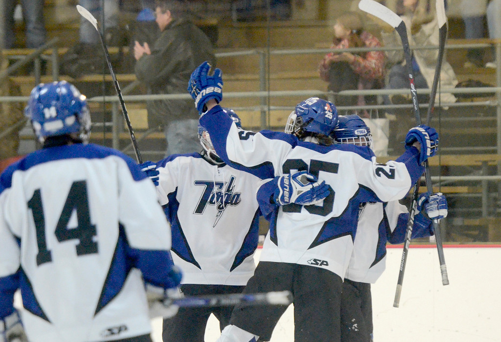 Description of . Ed Burke - The Saratogian 12/06/13 The Saratoga Springs Blue Streaks celebrate Josh Dagle's (25) first period goal over Mamaroneck Friday in the opening round of the Don Kauth Memorial Tournament.