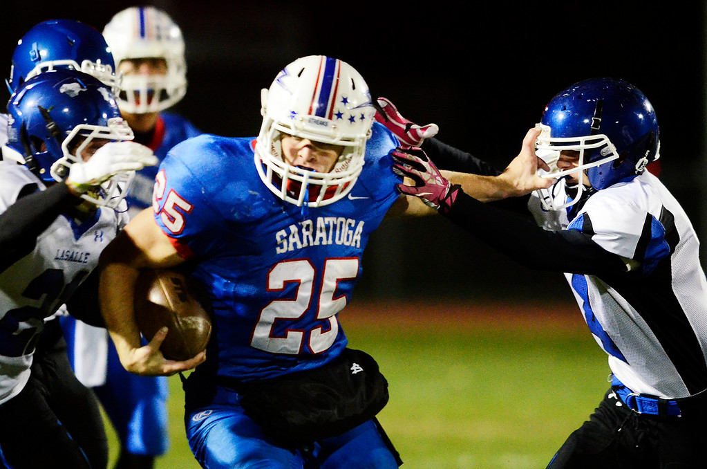 Description of . Erica Miller - The Saratogian @togianphotog      Saratoga's Dakota Harvey runs down the field during their playoff football game against LaSalle on Friday evening under the lights in Saratoga. SAR-l-SarFootball12