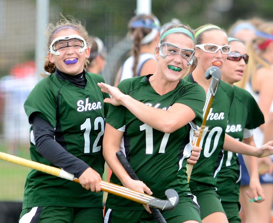 Description of . Shen's Anna Bottino (12) celebrates with teammates after scoring against Saratoga during Wednesday's varsity field hockey game at Saratoga. Ed Burke -  The Saratogian 10/16/13