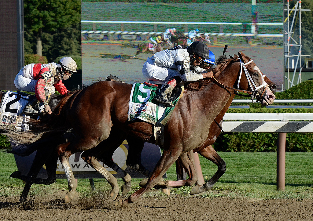 Description of . Will Take Charge and jockey Luis Saez (5) head for a victory by a nose over Moreno and Jose Ortiz in Saturday's Travers Stakes. Photo Ed Burke/SARATOGIAN 8/24/13