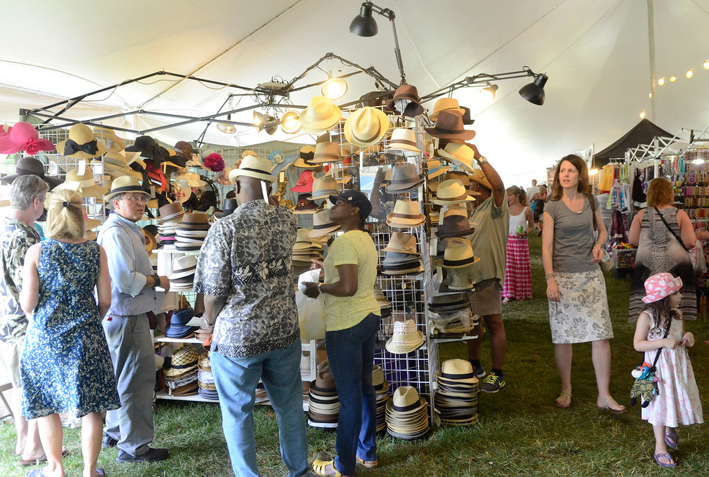 Description of . Ed Burke - The Saratogian 06/28/14 Jazz fans browse the wares in the vendors tent Saturday during the Freihofer Saratoga Jazz Festival at SPAC.