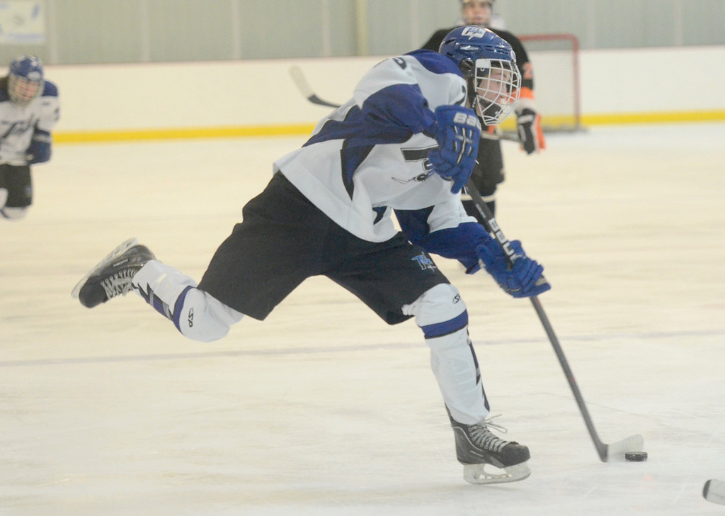 Description of . Ed Burke - The Saratogian 12/06/13 Saratoga's Josh Dagle takes a slapshot against Mamaroneck during Friday's opening round of the Don Kauth Memorial Tournament.
