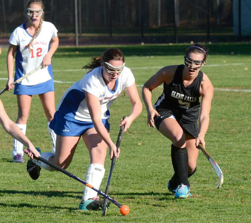 Description of . Ed Burke - the Saratogian South High varsity field hockey player Kelsy Baldwin is pressured by Cheyanne Randell, right, during the Bulldogs 1-0 semi-final win over Glens Falls Tuesday at South Glens Fall High School.