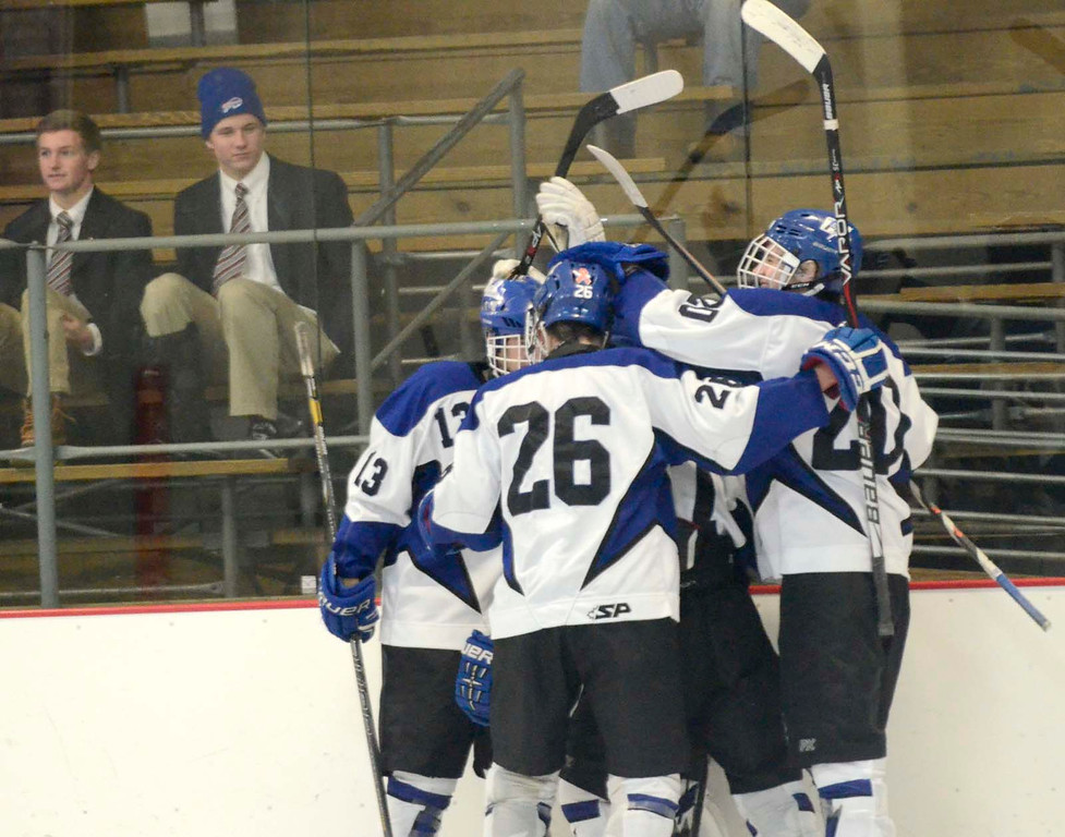 Description of . Ed Burke - The Saratogian 12/07/13 Saratoga Blue Streaks celebrate a first-period goal by Jake Fauler's against St. Joseph's during Saturday's action in the Don Kauth Memorial Tournament at Saratoga Springs Ice Rink.
