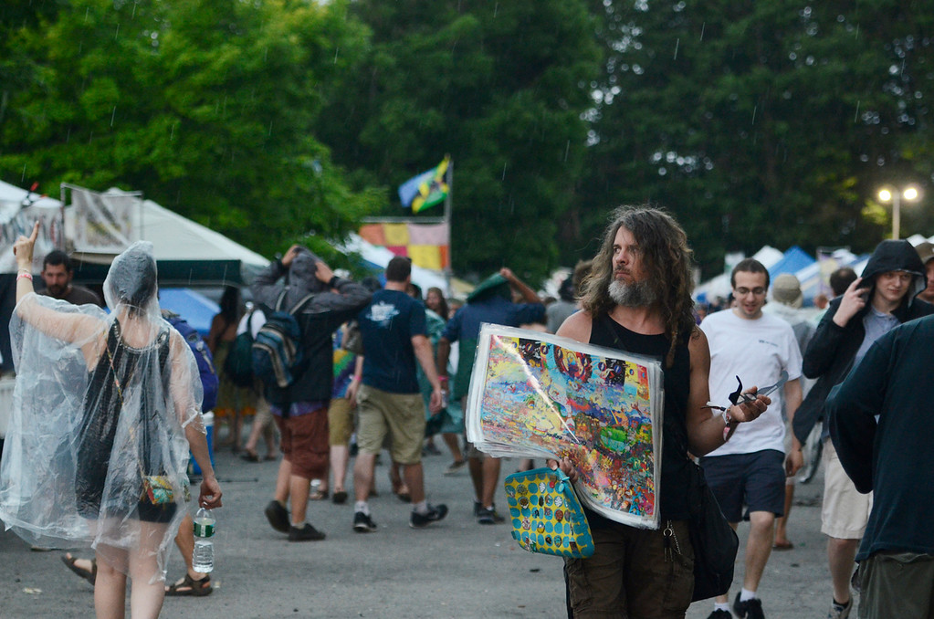 Description of . Erica Miller @togianphotog - The Saratogian:    On Thursday July 3rd 2014, Saratoga Springs was packed with thousands of Phish fans for their first of three concert nights at SPAC. Patrons made their way over to the bridge from Shack Shake towards the SPAC entrance.