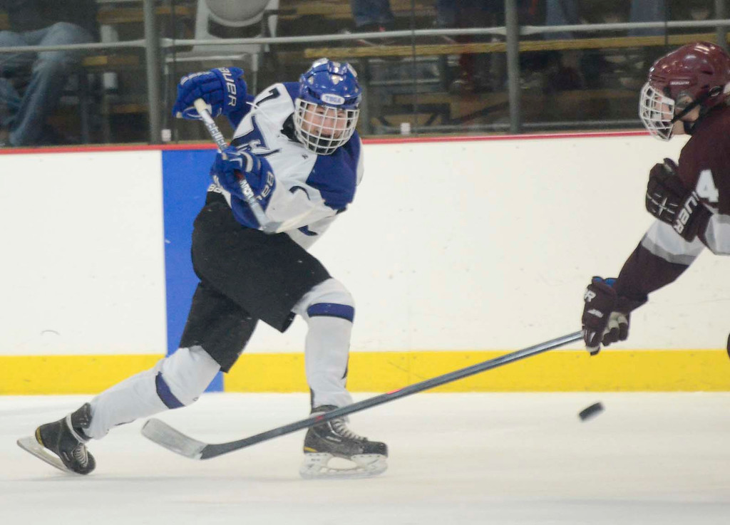 Description of . Ed Burke - The Saratogian 12/07/13 Saratoga's Devin Coffey shoots as St. Joseph's Brad Kaminski tries to block during Saturday's action in the Don Kauth Memorial Tournament at Saratoga Springs Ice Rink.