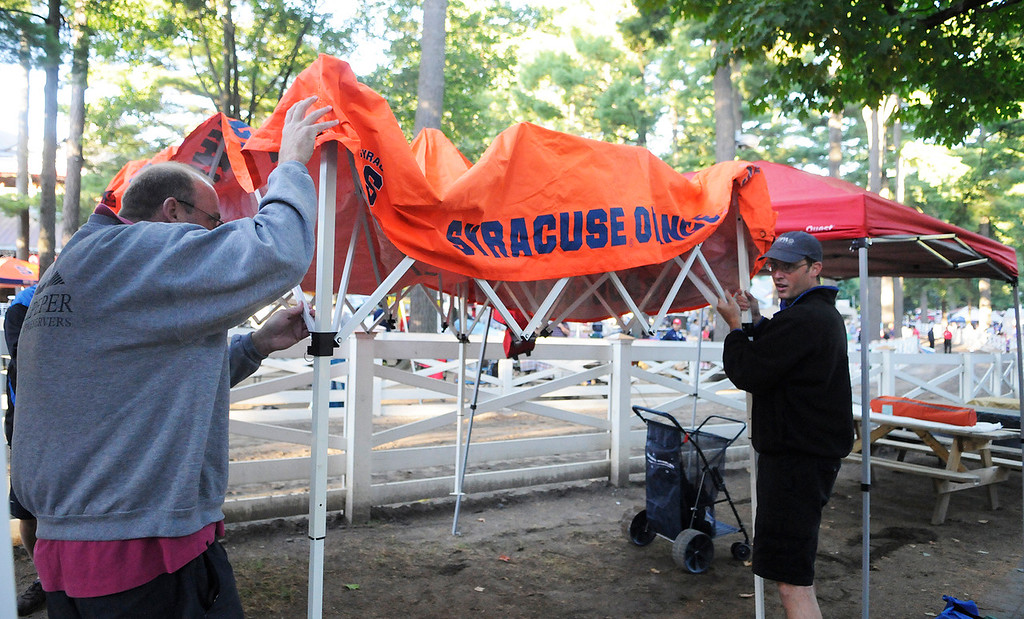 Description of . Patrons set up their picnic areas at their perfect location for the day on the backyard at the Saratoga Race Course for The Travers on Saturday morning.Photo Erica Miller/The Saratogian 8/24/13 news_TheMadDash9