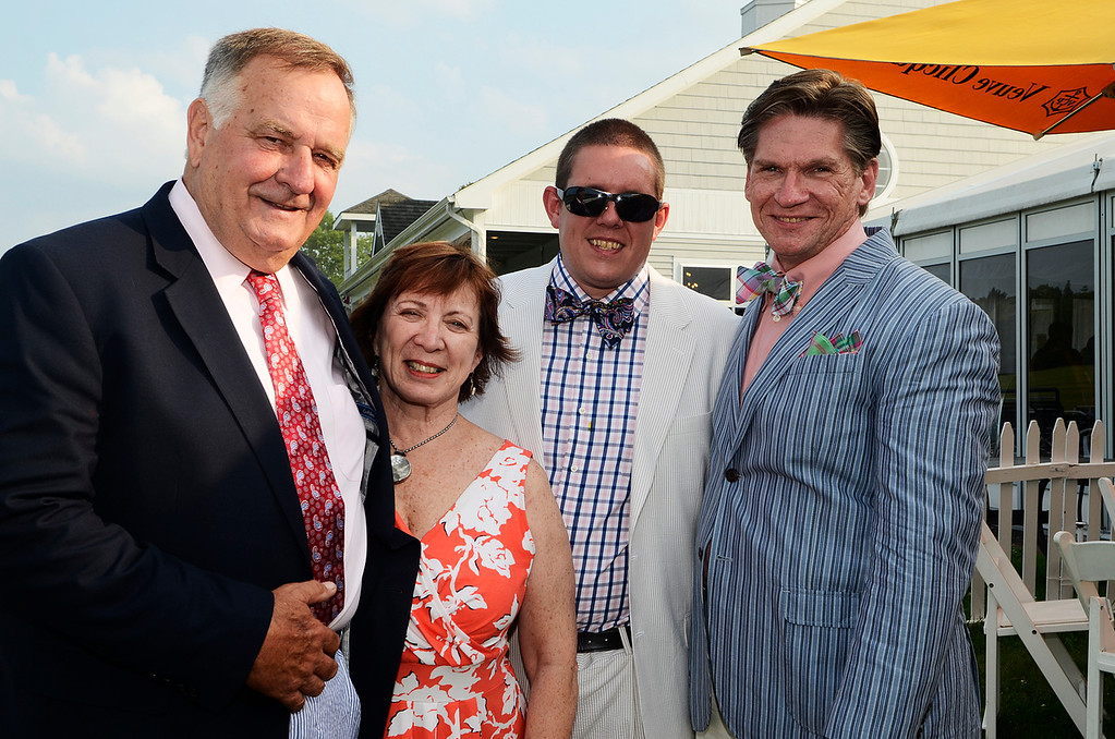Description of . Erica Miller @togianphotog - The Saratogian:     Tuesday evening at the Saratoga Polo Field grounds Skidmore held the Palamountain Scholarship Benefit Dinner. In attendance were (l-r) Peter Flaherty, Nancy Smith, Colby Smith and Dan Czech.