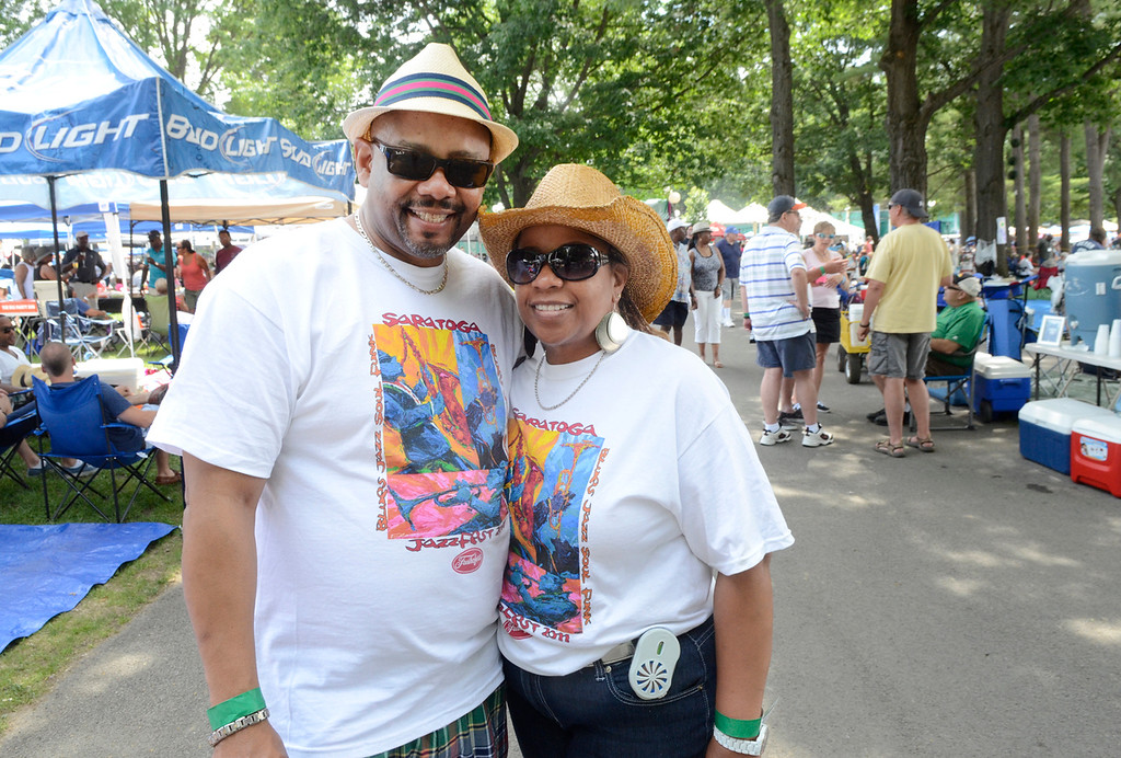 Description of . Ed Burke - The Saratogian 06/28/14 Sporting their new jazz fest t-shirts, Brad and Wanda Watts of Buffalo take in the sounds Saturday at the Freihofer Saratoga Jazz Festival.