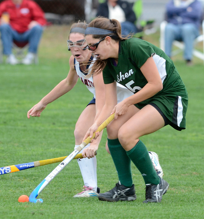 Description of . Saratoga's Marissa Folts tries to block an advance by Shen's Anna Branch during Wednesday's varsity field hockey game at Saratoga. Ed Burke -  The Saratogian 10/16/13