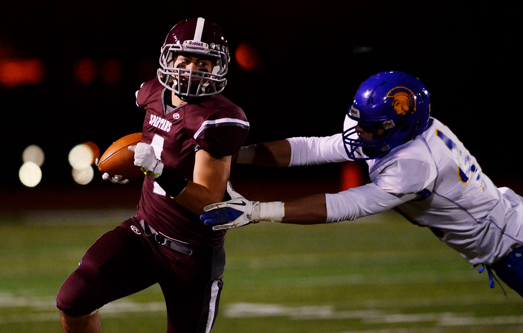 Description of . Erica Miller - The Saratogian @togianphotog      Burnt Hills-Ballston Lake's Daniel Porter carried the ball down the field against Queensbury's Jeffery Underhill for the Section 2 Class A Superbowl Saturday evening Nov. 9, 2013.SAR-l-footballs1