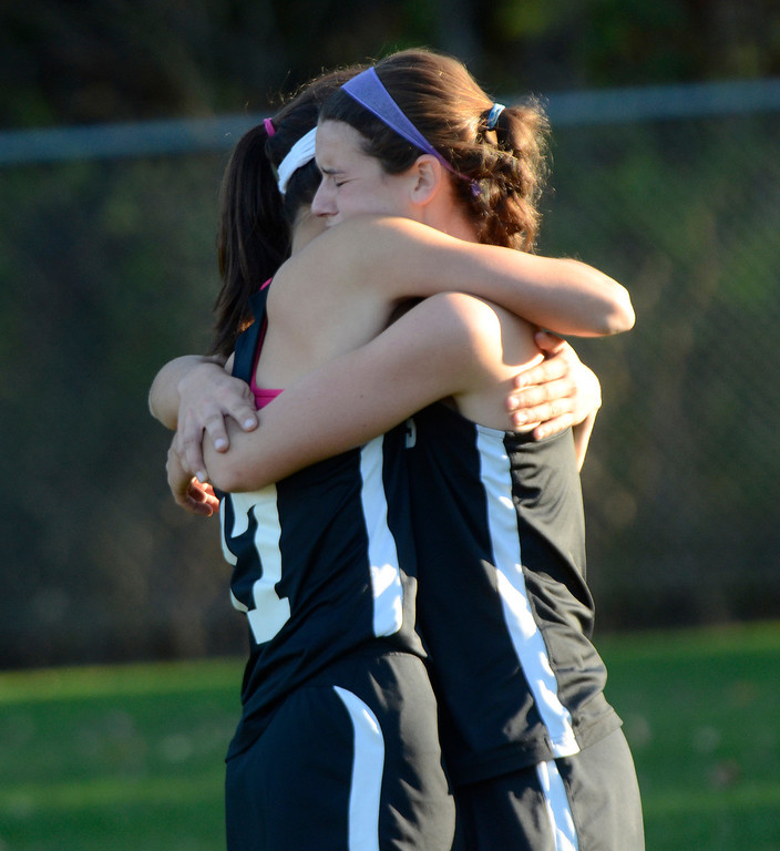 Description of . Ed Burke - the Saratogian 10/29/13 Glens Falls varsity field hockey players console each other Tuesday after their Class B semi-final loss to cross-river rivals South High.