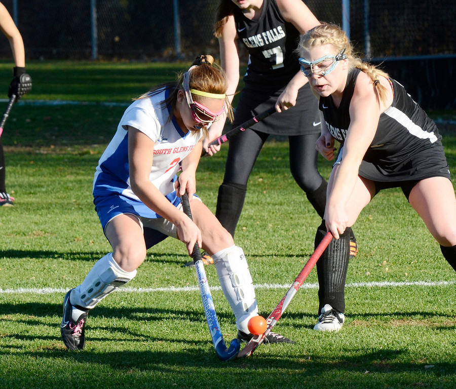 Description of . Ed Burke - the Saratogian South High varsity field hockey player Nicole Crawford is pressured by Allison Stanley during the Bulldogs 1-0 semi-final win over Glens Falls Tuesday at South Glens Fall High School.