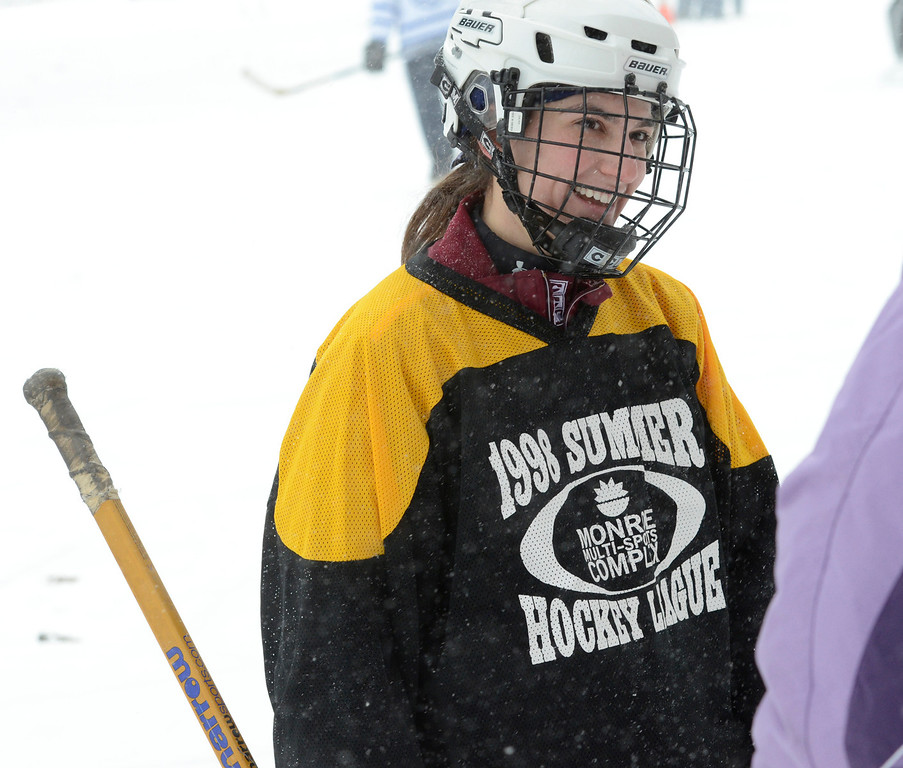Description of . Ed Burke - The Saratogian 01/25/14 Becky Jaiven of Schenectady suits up for team Lucky Puck Saturday during the Saratoga Frozen Springs Classic Hockey Tournament at Saratoga Spa State Park.