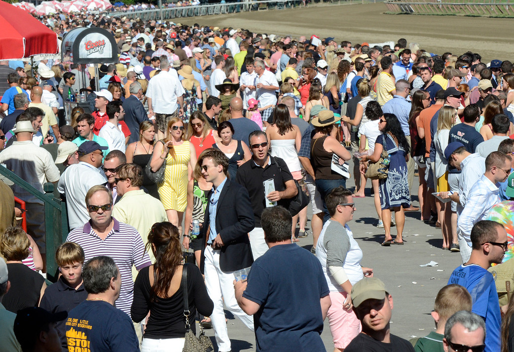 Description of . Prople crowd Saratoga Race Course Saturday on Travers day. Photo Ed Burke/SARATOGIAN 8/24/13