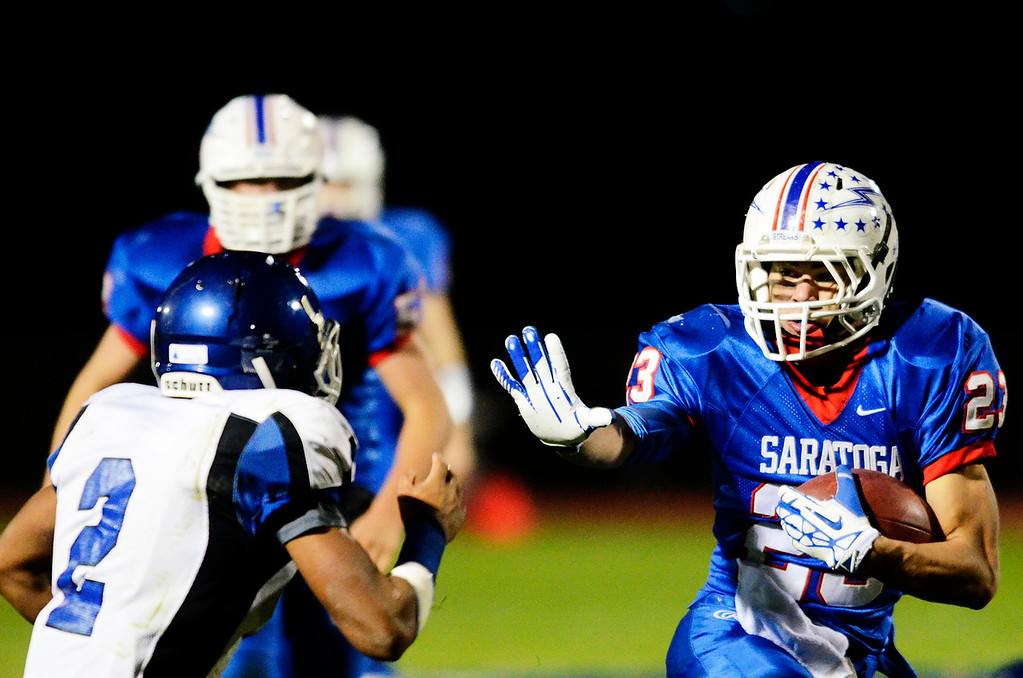 Description of . Erica Miller - The Saratogian @togianphotog      Saratoga's Jordan Wilcox runs down the field during their playoff football game against LaSalle on Friday evening under the lights in Saratoga. SAR-l-SarFootball14