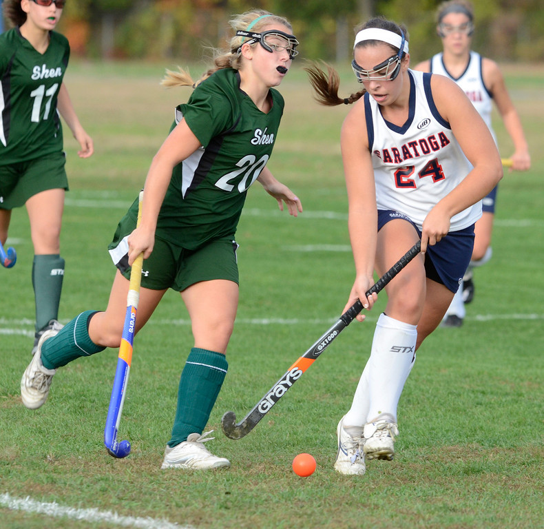 Description of . Saratoga's Anne Mahoney dribbles the ball ahead of Shen's Claire Virkler during Wednesday's varsity field hockey game at Saratoga. Ed Burke -  The Saratogian 10/16/13
