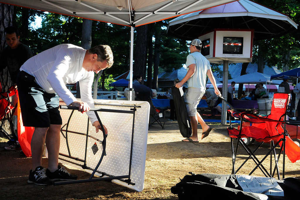 Description of . Patrons set up their picnic areas at their perfect location for the day on the backyard at the Saratoga Race Course for The Travers on Saturday morning.Photo Erica Miller/The Saratogian 8/24/13 news_TheMadDash8