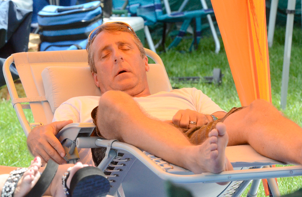 Description of . Ed Burke - The Saratogian 06/28/14 Pacing himself for a long weekend of jazz, a fan catches a nap Saturday during the Freihofer's Saratoga Jazz Festival at SPAC.