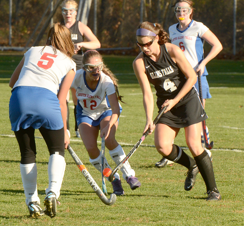 Description of . Ed Burke - the Saratogian South High varsity field hockey players Kyerna Richards (5) and Lauren Yakush pressure Glens Falls'  Monica Harvey during the Bulldogs 1-0 semi-final win over Tuesday at South Glens Fall High School.