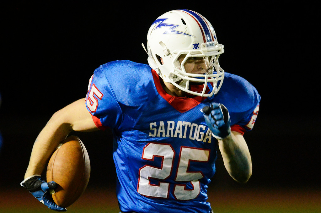 Description of . Erica Miller - The Saratogian @togianphotog      Saratoga's Dakota Harvey with the third touchdown after an interception during their playoff football game against LaSalle on Friday evening under the lights in Saratoga. SAR-l-SarFootball1