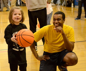 Ed Burke - The Saratogian 01/18/14 James Foster, an Electronic Technician with the U.S. Navy based at the Navy's Nuclear Power Training Unit in Ballston Spa, works with six year old Sarah Hassett of Stillwater during the SAFE basketball program Saturday at Okte Elementary School in Clifton Park. Sports Are For Everyone (SAFE) officially partnered with the Navy during a ceremony Saturday at the school. SAFE was founded in 1992 by Jim Fitzgerald to ensure those with special needs were able to participate in sports and build friendships and self-confidence.