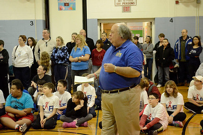 Ed Burke - The Saratogian 01/18/14 Surrounded by SAFE athletes and their families, program founder Jim Fitzgerald welcomes the U.S. Navy on board Saturday at Okte Elementary School in Clifton Park. Sports Are For Everyone (SAFE) officially partnered with the Navy during a ceremony at the school. SAFE was founded in 1992 by Fitzgerald to ensure those with special needs were able to participate in sports and build friendships and self-confidence.