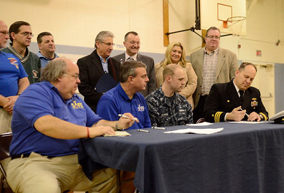 Ed Burke - The Saratogian 01/18/14 Local officials, including Assembyman James Tedisco, look on Saturday at Okte Elementary School in Clifton Park as Captain Jim Edwards signs paperwork partnering the Navy with Sports Are For Everyone (SAFE). SAFE was founded in 1992 by Jim Fitzgerald to ensure those with special needs were able to participate in sports and build friendships and self-confidence. Seated from left are Jim Fitzgerald and Jim Murphy of SAFE, Navy Hull Technician Chris Merrow and Capt. Edwards.