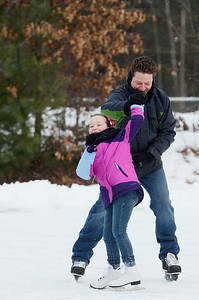 Erica Miller @togianphotog	- The Saratogian,   At the Gavin Park ice skating rink, on Monday Jan. 20th, 2014,  Michael Sawicz twirls his daughter Macy, 7 years old, on their day off from school, Martin Luther King's Day's remembrance.