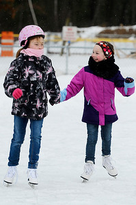 Erica Miller @togianphotog	- The Saratogian,   At the Gavin Park ice skating rink, on Monday Jan. 20th, 2014,  Macy Sawicz, 7 years old, skates with friend Jenna Hart, 8 years old, on their day off from school, Martin Luther King's Day's remembrance.