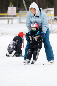 Erica Miller @togianphotog	- The Saratogian,   At the Gavin Park ice skating rink, on Monday Jan. 20th, 2014, Nicole Griffiths helps her four year old son Gavin skate on their day off from school, Martin Luther King's Day's remembrance.