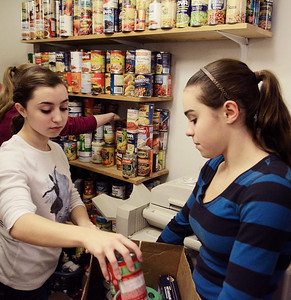 Erica Miller @togianphotog	- The Saratogian,   Triplets Lauren (left) and Rachel Venditti, 16 year old Sophomores at SSHS, stocked the shelves at Shelters of Saratoga. Monday Jan. 20th, 2014, in celebration of Martin Luther Kings Day, the community gathered to help local non-for-profits in the city.