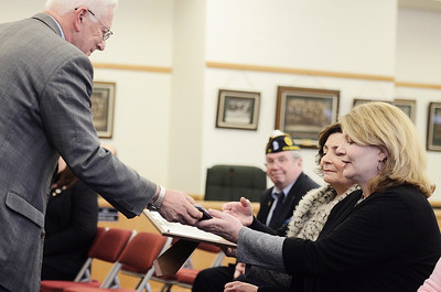 Erica Miller @togianphotog- The Saratogian,   Saratoga County Board of Supervisor Chairman Paul Sausville, Malta Supervisor, gave Tracy Egan awards in honor of her late father William Wilson Egan. Egan was honored during the monthly, Tuesday Jan 21, 2014, for the County Deceased Veteran's Ceremony.