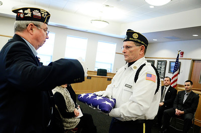 Erica Miller @togianphotog- The Saratogian,   At the Saratoga County Board of Supervisor's Chaplain Everett Manning, Post 234, gave Bill McBridd, Post 91 Mechanicville, the flag in honor of William Wilson Egan, flown for one month. Egan was honored during the monthly, Tuesday Jan 21, 2014, for the County Deceased Veteran's Ceremony.
