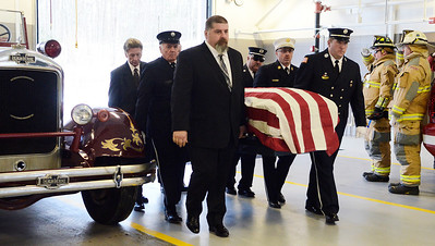 Erica Miller @togianphotog- The Saratogian, The funeral of a dedicated fireman, Louis Pasquarell Sr. of Jonesville Fire Department was laid to rest on Friday, Jan. 24th, 2014. He served 77 years as a fireman. The funeral was held at the Corpus Christi Church, Ushers 2001 Route 9, Round Lake.  Jonesville fireman move his casket into the funeral car at Station 2.